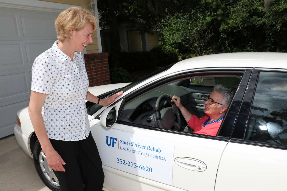 Certified Driver Rehabiliation Specialist with a client at UF SmartDriver Rehab